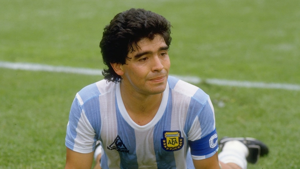 10 Jun 1986: Diego Maradona of Argentina gets up from the pitch during the World Cup match against Bulgaria at the Olympic Stadium in Mexico City. Argentina won the match 2-0.