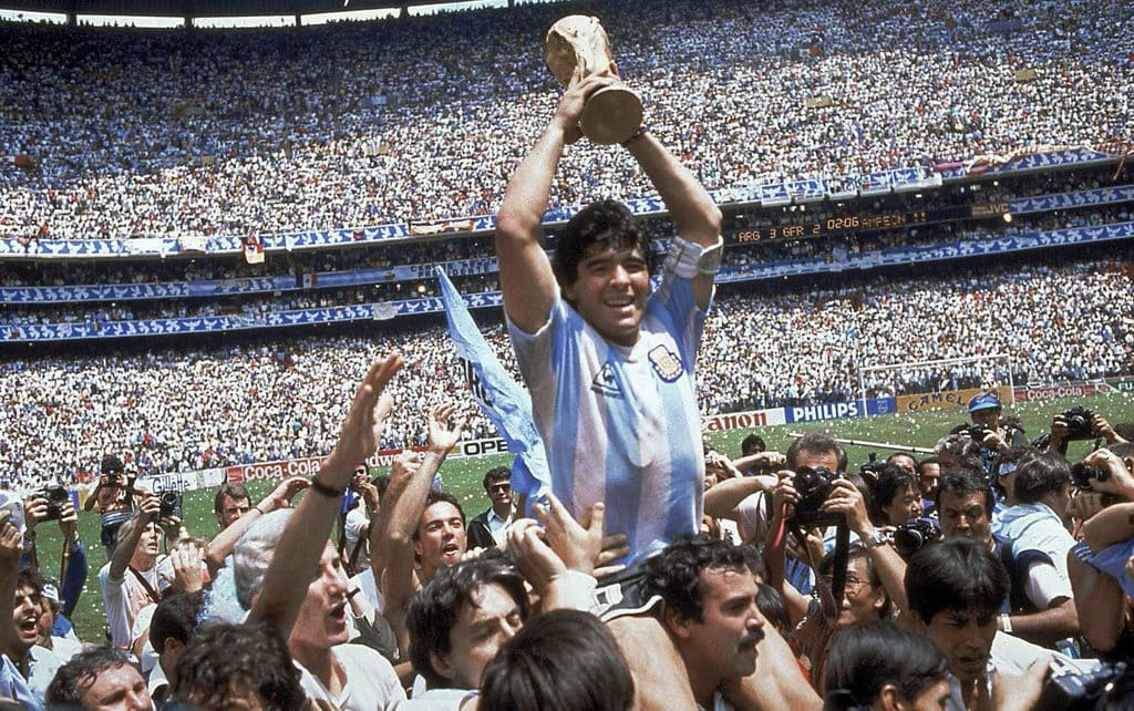June 29, 1986 file photo, Diego Maradona of Argentina, is lifted up as he holds the World Cup trophy after Argentina defeated West Germany 3-2 in the World Cup soccer final in the Atzeca Stadium, in Mexico City.