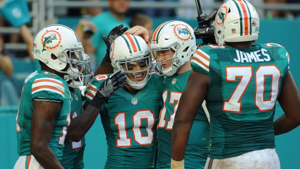 Miami Dolphins Wearing Their Throwback Uniforms