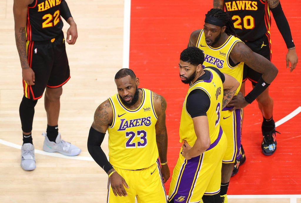 LeBron James and his teammates wait as the game was stopped by referees to eject 2 crowd members.