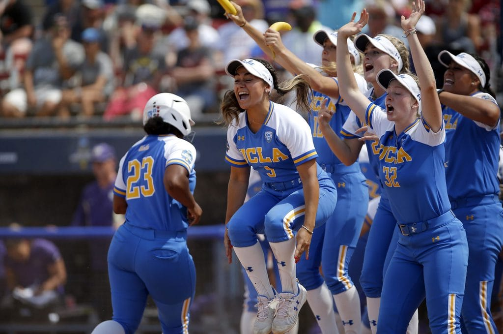 UCLA players celebrate Rachel Garcia's three-run home run in the 10th inning against Washington during the Women's College World Series in Oklahoma City, Sunday, June 2, 2019