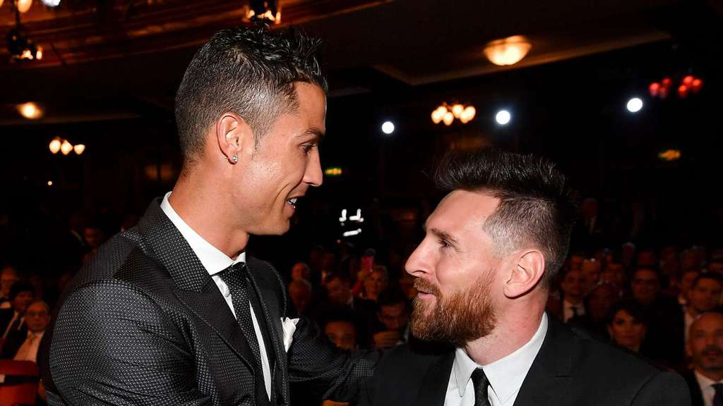 Ronaldo and Messi during an official event