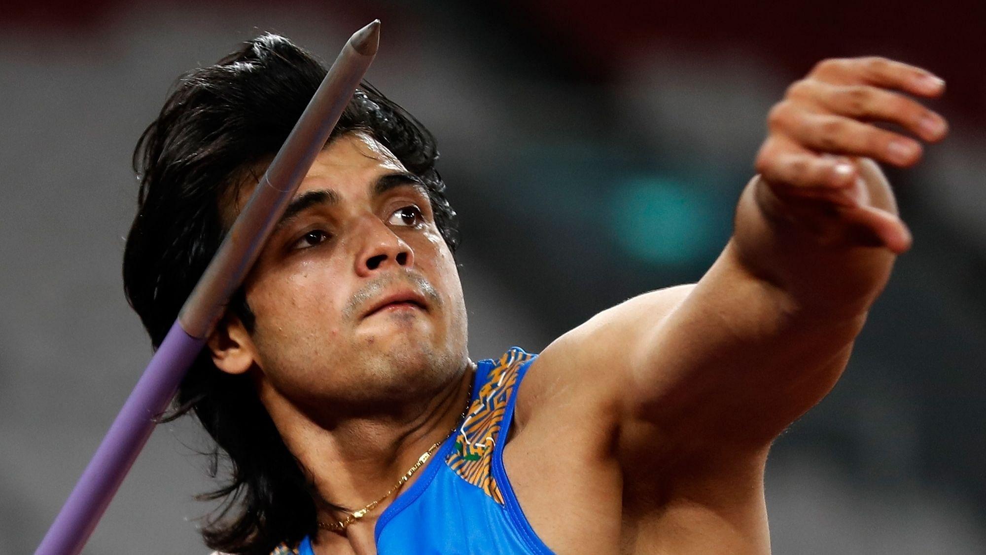 Neeraj Chopra throwing a javelin at the 2020 Tokyo Olympics