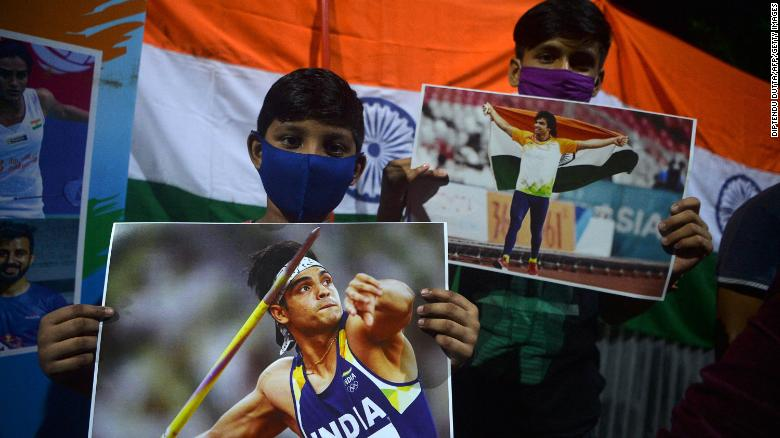 Supporters of India's athlete Neeraj Chopra celebrate after he won the gold medal in the men's javelin throw during the Tokyo 2020 Olympic Games.