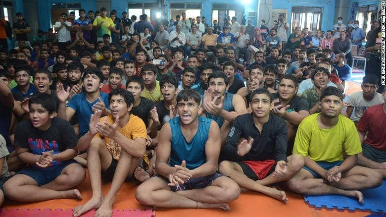 Young athletes in New Delhi on the TV as the wrestler Ravi Kumar Dahiya takes home the bronze medal in his weight category in Tokyo.