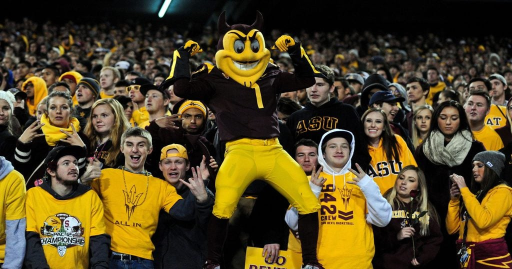 College sports fans from Arizona State University cheer on their football team.