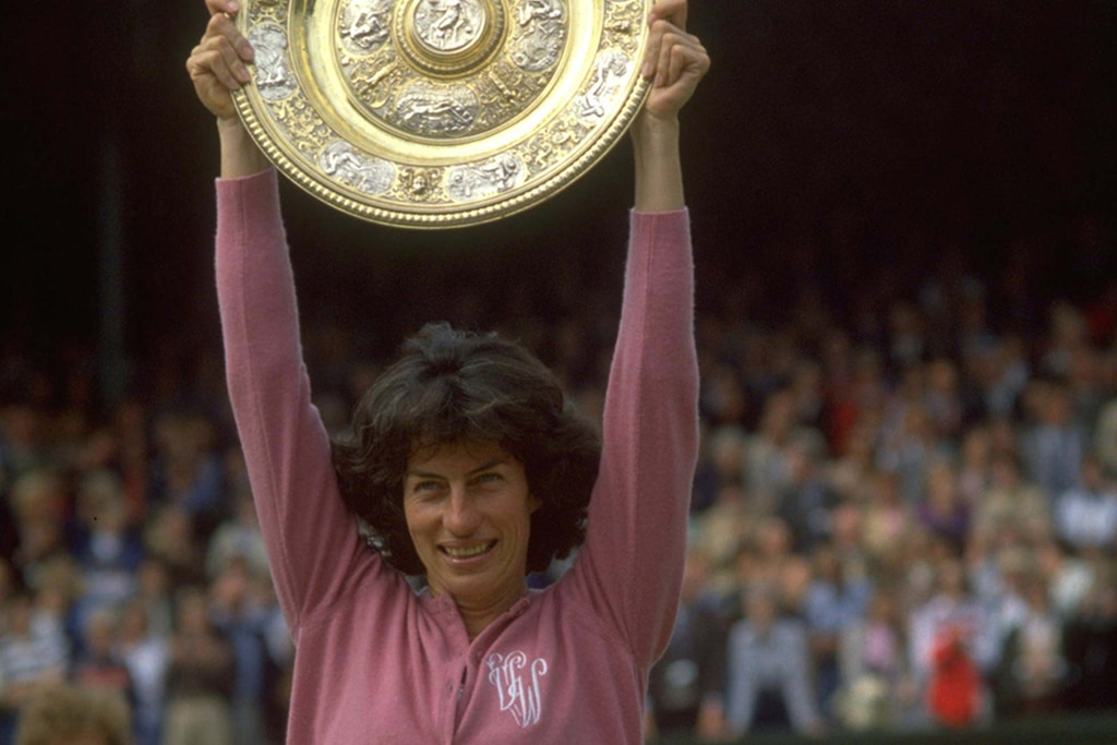 Virginia Wade posing with the 1977 Wimbledon woman's singles trophy.