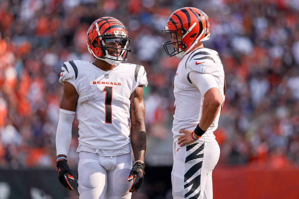 Ja'Marr Chase, WR for Cincinnati Bengals talking to a teammate.